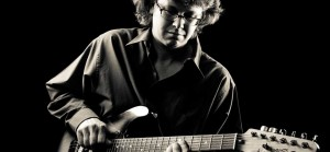 Tim Ainslie playing guitar